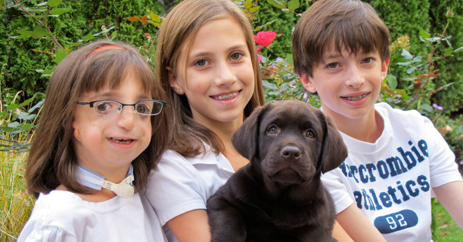clara-beatty-poses-with-the-family-dog-and-her-siblings670